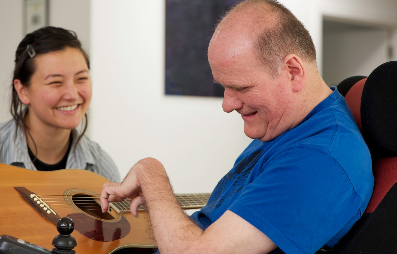 disabled person playing guitar